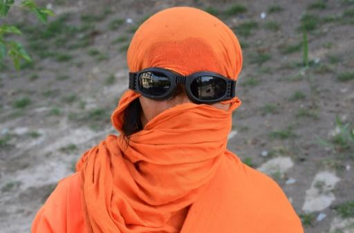 The women working in Jalabad's public gardens wear an ample fluorescent orange work blouse -- a stark contrast to the traditional sky-blue burka worn by the few other women seen in public in the city