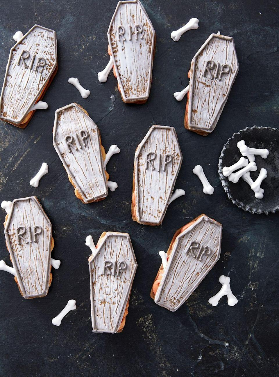 """<p>It's a lot easier to make these cookies than you might think. Simply drag a fork through the royal icing before it sets to get that """"distressed look."""" A quick orange buttercream acts as the filling here.</p><p><strong><a href=""""https://www.countryliving.com/food-drinks/a28943552/coffin-sandwich-cookies/"""" rel=""""nofollow noopener"""" target=""""_blank"""" data-ylk=""""slk:Get the recipe"""" class=""""link rapid-noclick-resp"""">Get the recipe</a>.</strong> </p>"""