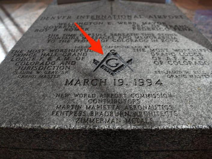 """A time capsule scribed with a Freemason symbol and the words """"New World Airport Commission"""" at Denver International Airport."""