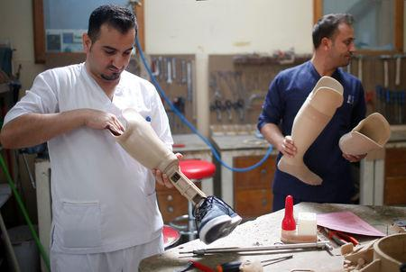 Technicians produce artificial limbs at Red Cross Physical Rehabilitation Centre in Erbil, Iraq April 2, 2017.  Picture taken April 2, 2017. REUTERS/Suhaib Salem