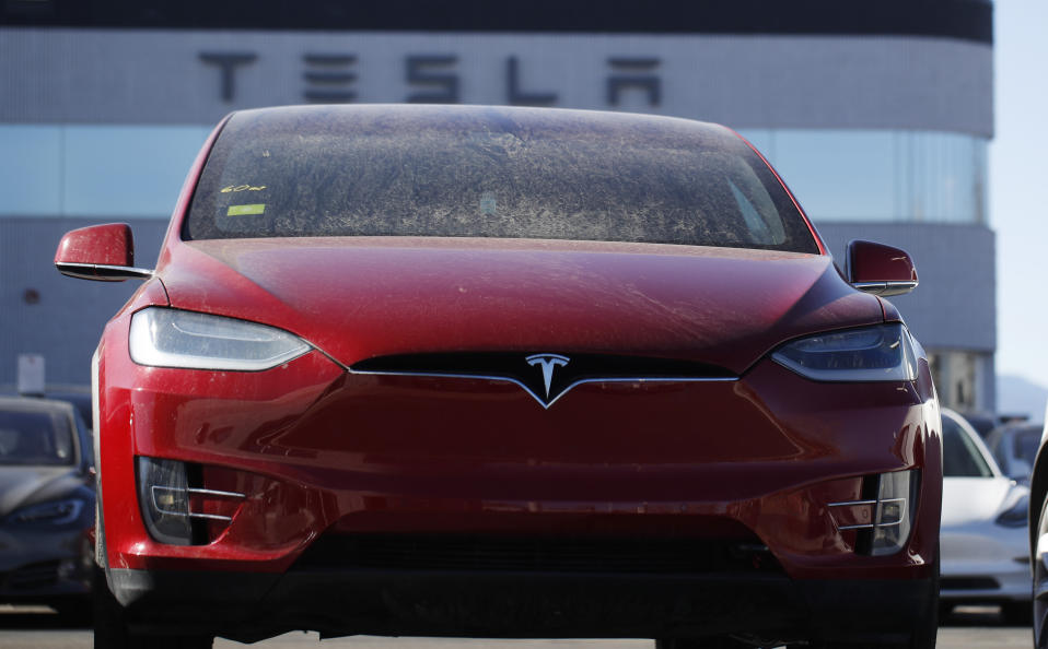 In this Sunday, Feb. 2, 2020, photograph, aN unsold 2020 Model X sits at a Tesla dealership in Littleton, Colo. (AP Photo/David Zalubowski)