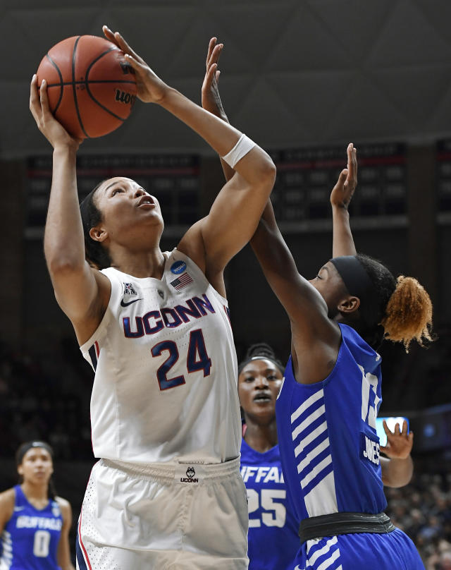 Connecticut's Napheesa Collier, left, shoots over Buffalo's Autumn Jones during the first half of a second-round women's college basketball game in the NCAA tournament Sunday, March 24, 2019, in Storrs, Conn. (AP Photo/Jessica Hill)