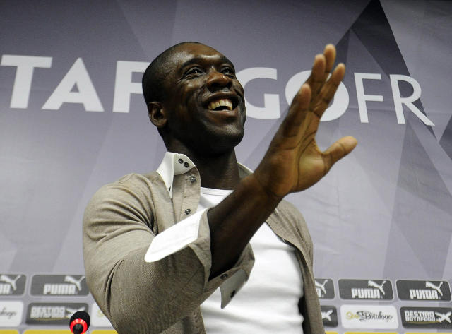 Dutch soccer player Clarence Seedorf gestures at a press conference at the Brazilian club Botafogo, where the midfielder has been playing in Rio de Janeiro, Brazil, Tuesday, Jan. 14, 2014. Seedorf said Tuesday he will take over as the new coach at AC Milan, replacing Massimiliano Allegri who was fired the day before. (AP Photo/Fabio Castro, AGIF)