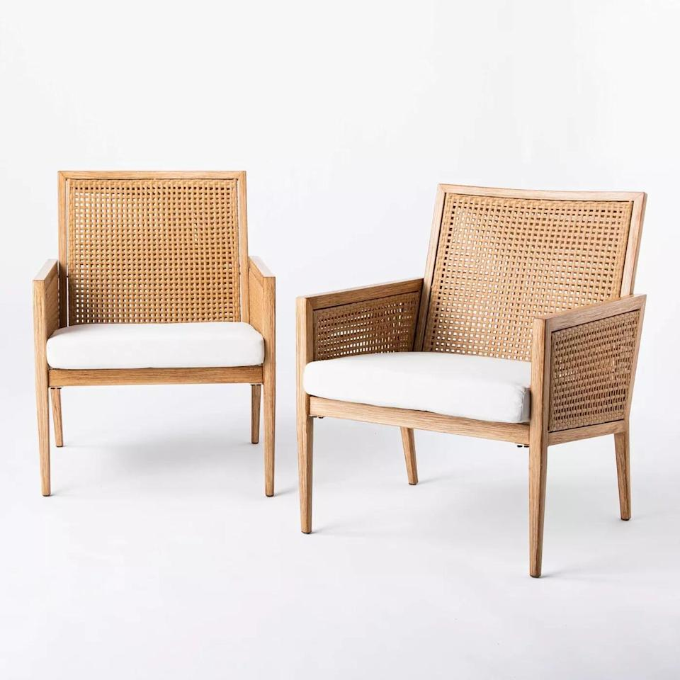 <p>The <span>Benmore Wicker and Faux Wood Patio Accent Chairs</span> ($380) are so warm and inviting, everyone will want to hang out on your patio. </p>
