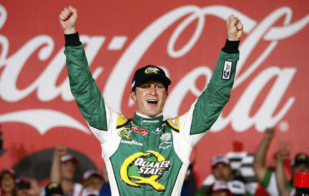 FILE PHOTO: Driver Kasey Kahne celebrates after winning the NASCAR Sprint Cup Series Coca-Cola 600 autorace in Concord, North Carolina May 27, 2012. REUTERS/Chris Keane
