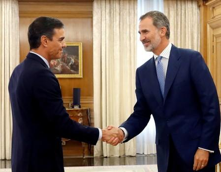 Spain's King Felipe greets acting Prime Minister Pedro Sanchez before their meeting in Madrid