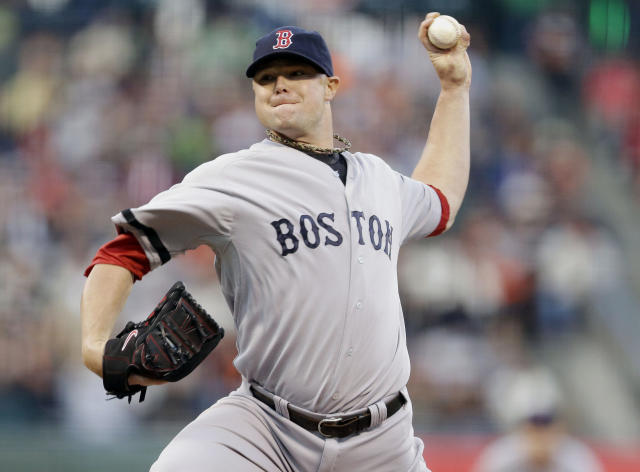 Boston Red Sox starting pitcher Jon Lester throws to the San Francisco Giants during the first inning of a baseball game on Monday, Aug. 19, 2013, in San Francisco. (AP Photo/Marcio Jose Sanchez)