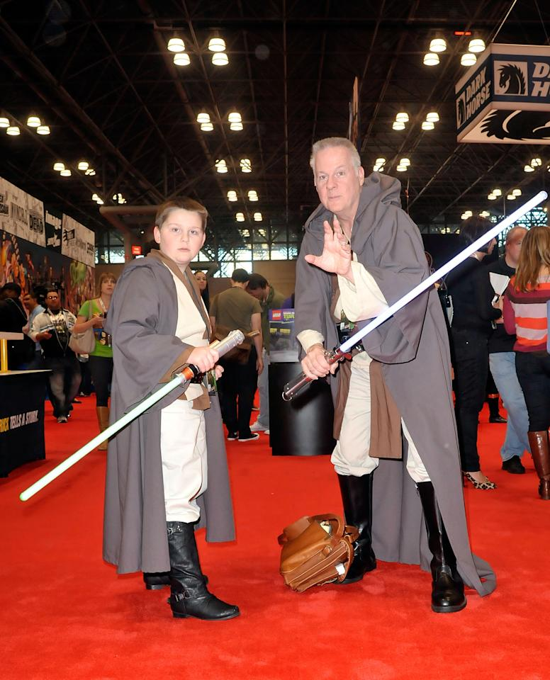 Comic Con attendees wearing Star Wars costumes pose during the 2012 New York Comic Con at the Javits Center on October 11, 2012 in New York City.  (Photo by Daniel Zuchnik/Getty Images)