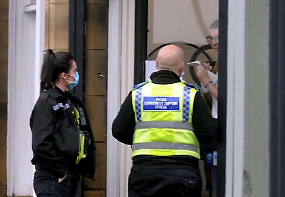 """Quinn Blakey Hairdressing, on Bradford Road, Oakenshaw is visited by two PCSOs as they appeared to be staying open in defiance of lockdown restrictiond, November 10 2020. See SWNS story SWLEhair. A hair salon appears to have rebelled against the current lockdown rules by staying open despite the tightened coronavirus restrictions. Quinn Blakey Hairdressing, on Bradford Road, Oakenshaw, was seemingly open for business yesterday and at one point, police community support officers arrived at the premises.  Prime Minister Boris Johnson ordered certain businesses - including hairdressers - to close from November 5 in the face of rising Covid-19 cases. On the same day, a post on the salon's Facebook page said: """"I earned this week's rent today, not sure where I would be pulling that money from given the government want self employed business people to wait SIX WEEKS for a payment."""