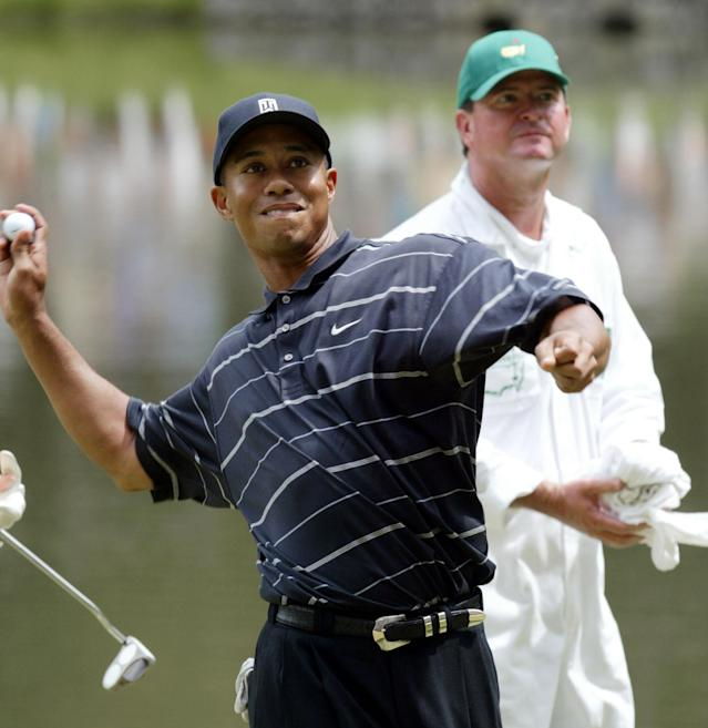 <p>Defending Masters champion Tiger Woods tosses his golf ball to the gallery gathered at the 9th hole after finishing the Par 3 Contest at the Augusta National Golf Club Wednesday, April 10, 2002, in Augusta, Ga. First round play of the 2002 Masters begins on Thursday. (AP Photo/Doug Mills) </p>