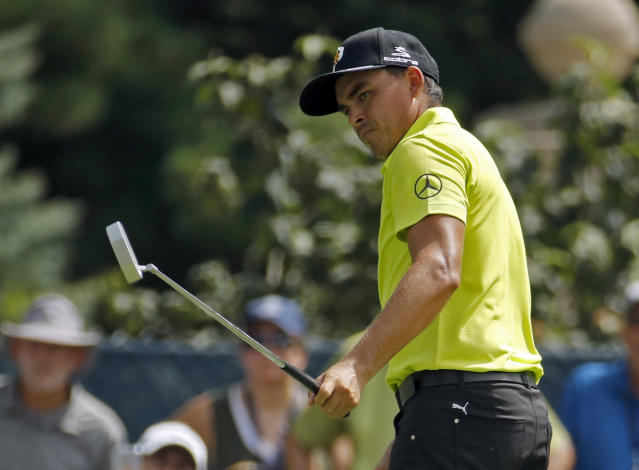 Rickie Fowler watches a putt on the fifth hole during the first round of the PGA Championship golf tournament at Bellerive Country Club, Thursday, Aug. 9, 2018, in St. Louis. (AP Photo/Charlie Riedel)