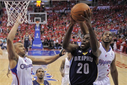 Memphis Grizzlies forward Quincy Pondexter, center, puts up a shot against Los Angeles Clippers guard Chris Paul, right, and forward Caron Butler during the first half of Game 6 in their first-round NBA basketball playoff series, Friday, May 11, 2012, in Los Angeles. (AP Photo/Mark J. Terrill)