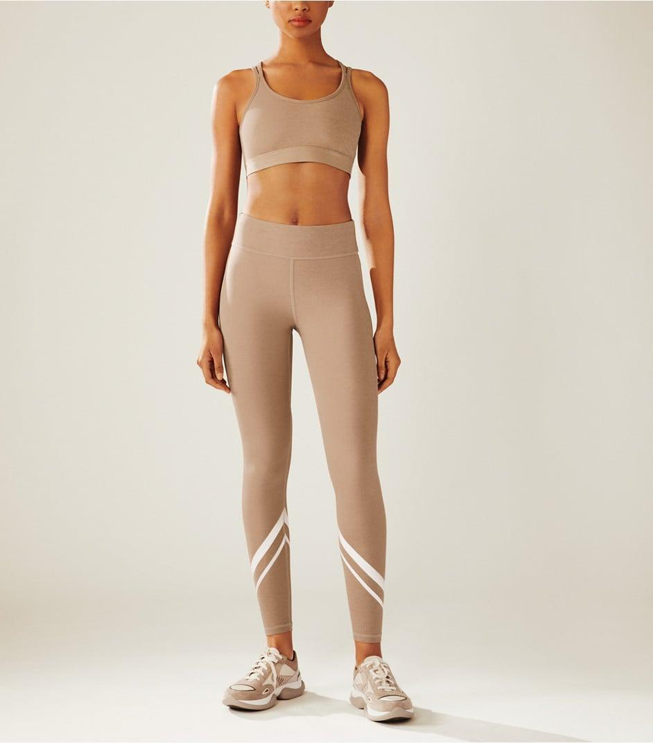 <p>We can definitely get into this adorable <span>Tory Sport Compression Mélange Cross-Back Bra</span> ($88) and <span>Chevron Side-Pocket Leggings</span> ($148).</p>