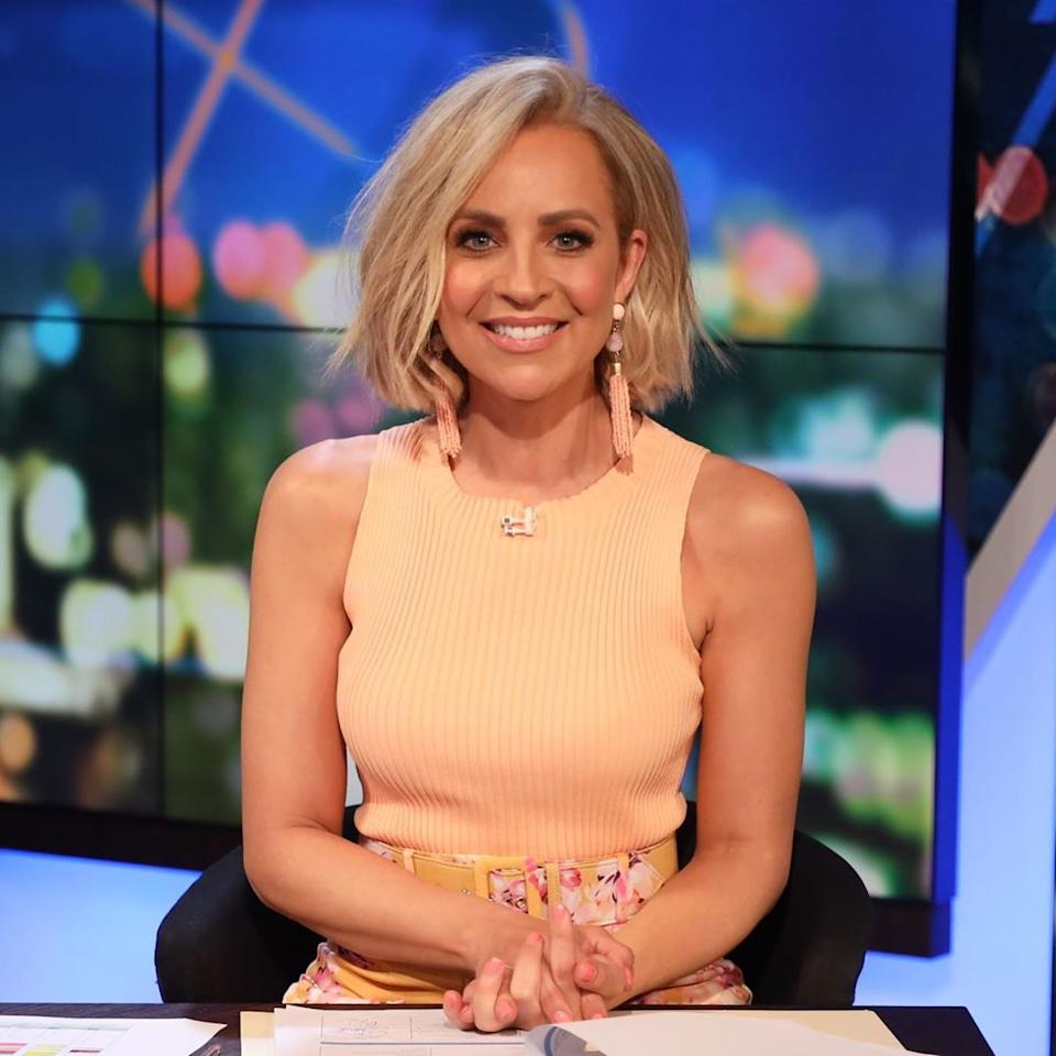 Carrie Bickmore in a yellow top on The Project