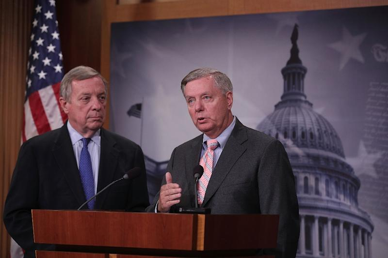"""Democratic Senator Dick Durbin (L) and Republican Senator Lindsey Graham (R) -- shown here in September -- are leading efforts to codify protections for so-called """"Dreamers,"""" immigrants who came to the United States illegally as children (AFP Photo/ALEX WONG)"""