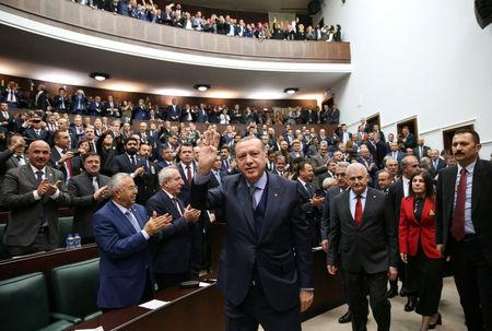 Turkish President Erdogan greets members of parliament of his ruling AK Party during a meeting at the Parliament in Ankara