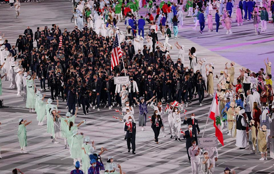 TOKYO, JAPAN - JULY 23: Flag bearers Sue Bird and Eddy Alvarez of Team United States lead their team in during the Opening Ceremony of the Tokyo 2020 Olympic Games at Olympic Stadium on July 23, 2021 in Tokyo, Japan. (Photo by Patrick Smith/Getty Images)