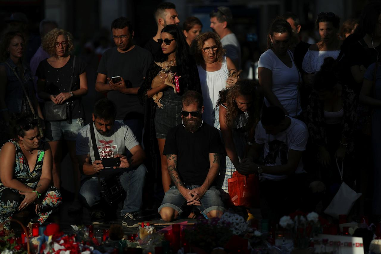 People gather at an impromptu memorial where a van crashed into pedestrians at Las Ramblas in Barcelona, Spain, August 20, 2017. REUTERS/Susana Vera