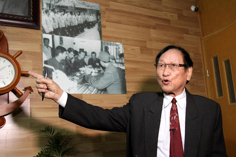 Tran Trong Duyet, John McCain's wartime jailor, points to photos of US prisoners of war on display at his home (AFP Photo/Nhac NGUYEN)