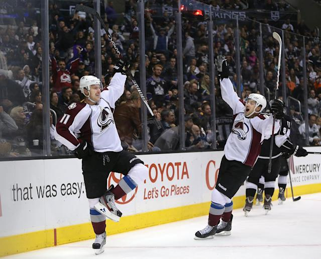 LOS ANGELES, CA - NOVEMBER 23: Jamie McGinn #11 and John Mitchell #7 of the Colorado Avalanche react after McGinn scored in overtime to defeat the Kings 1-0 in the NHL game at Staples Center on November 23, 2013 in Los Angeles, California. (Photo by Victor Decolongon/Getty Images)