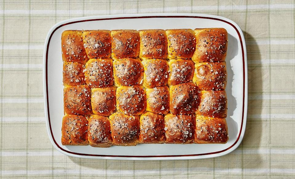 "These melt-in-your-mouth dinner rolls, from Claire Saffitz's cookbook <a href=""https://www.amazon.com/Dessert-Person-Recipes-Guidance-Confidence/dp/1984826964"" rel=""nofollow noopener"" target=""_blank"" data-ylk=""slk:Dessert Person"" class=""link rapid-noclick-resp""><em>Dessert Person</em></a>, are even more tender and pillowy than the classic <a href=""https://www.bonappetit.com/recipe/parker-house-rolls?mbid=synd_yahoo_rss"" rel=""nofollow noopener"" target=""_blank"" data-ylk=""slk:Parker House rolls"" class=""link rapid-noclick-resp"">Parker House rolls</a> that inspired this recipe. That's thanks to the addition of tangzhong, a white roux made from flour and milk cooked to a stiff paste, often used to make Japanese milk bread. The cooked starches in the tangzhong help the dough retain moisture and keeps the rolls super soft and light. The slight onion flavor of chives and tang of sour cream give them oomph. They're as equally excellent at mopping up gravy as they are at holding the contents of a leftover turkey sandwich. ""If food could give you a hug, these rolls definitely would,"" says Claire. <a href=""https://www.bonappetit.com/recipe/pull-apart-sour-cream-and-chive-rolls?mbid=synd_yahoo_rss"" rel=""nofollow noopener"" target=""_blank"" data-ylk=""slk:See recipe."" class=""link rapid-noclick-resp"">See recipe.</a>"