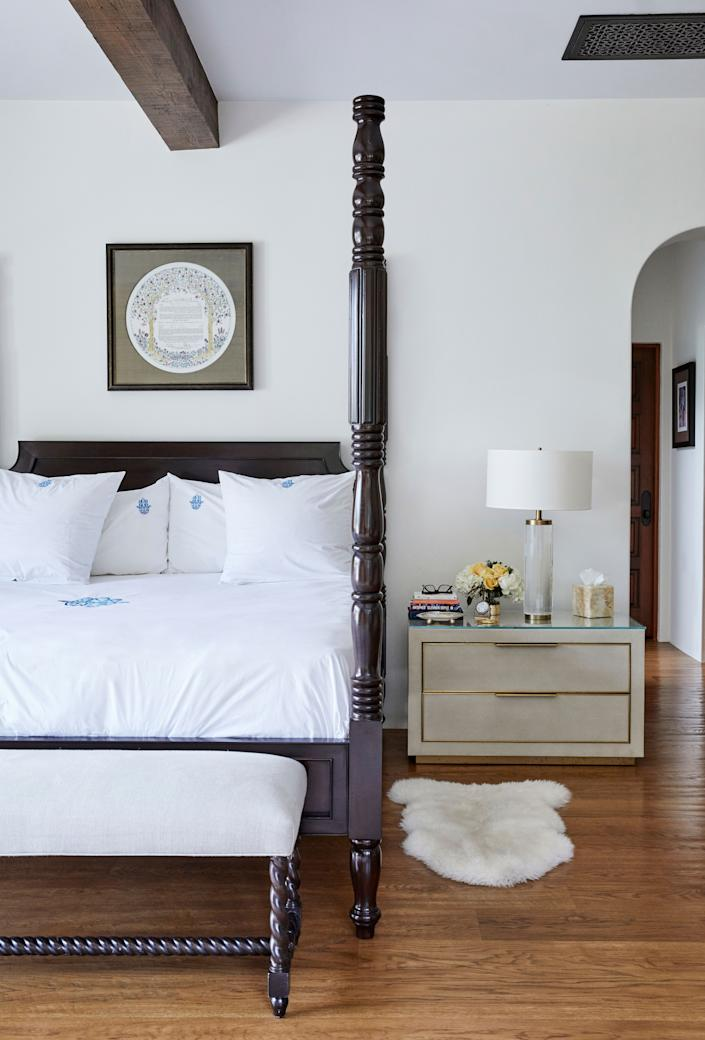 "<div class=""caption""> The main bedroom's most striking feature is the four-poster bed and bench by <a href=""https://www.postobello.com/"" rel=""nofollow noopener"" target=""_blank"" data-ylk=""slk:Postobello"" class=""link rapid-noclick-resp"">Postobello</a>, with linens from <a href=""https://prettylinge.com/index.php?"" rel=""nofollow noopener"" target=""_blank"" data-ylk=""slk:Pretty Linge Marrakech"" class=""link rapid-noclick-resp"">Pretty Linge Marrakech</a>. Above the bed hangs the couple's wedding ketubah. </div>"