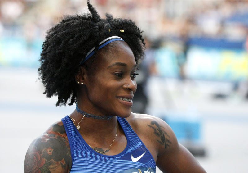 Elaine Thomson of Jamaica smiles after winning the women's 100m the IAAF Diamond League athletics meeting at Charlety Stadium in Paris, Saturday, Aug. 24, 2019. (AP Photo/Michel Spingler)
