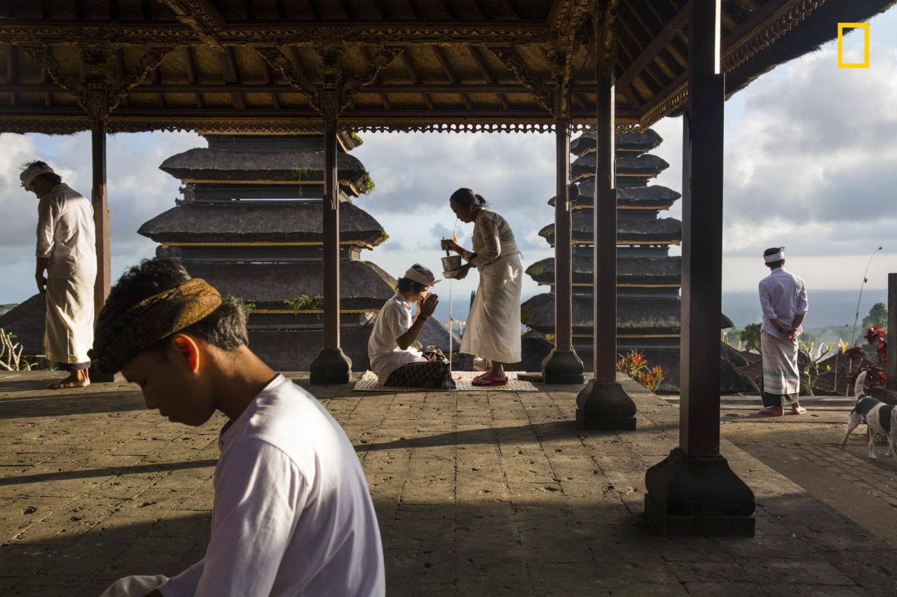 <p>Balinese worshippers pray at the Besakih Temple of the, 1,000 metres high on the slopes of Mount Agung. (Michael Dean Morgan/National Geographic travel photographer of the year) </p>