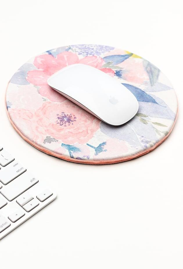 "<p>Make this <a href=""http://thecraftedlife.com/diy-floral-mouse-pad-for-spring/"" target=""_blank"" class=""ga-track"" data-ga-category=""Related"" data-ga-label=""http://thecraftedlife.com/diy-floral-mouse-pad-for-spring/"" data-ga-action=""In-Line Links"">feminine floral mouse pad</a> for a friend or coworker.</p>"