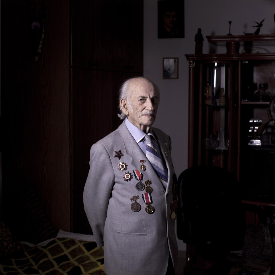 In this photo made Friday, April 12, 2013, Soviet Jewish World War Two veteran Semion Tzvang 89, poses for a portrait at his house in the southern Israeli city of Ashkelon. Tzvang joined the Red Army in 1941 and served in the First Ukrainian Front, a Soviet army group. He fought in Kiev, Prague and Berlin. Tzvang immigrated to Israel in 1991. About 500,000 Soviet Jews served in the Red Army during World War Two, and the majority of those still alive today live in Israel. (AP Photo/Oded Balilty)