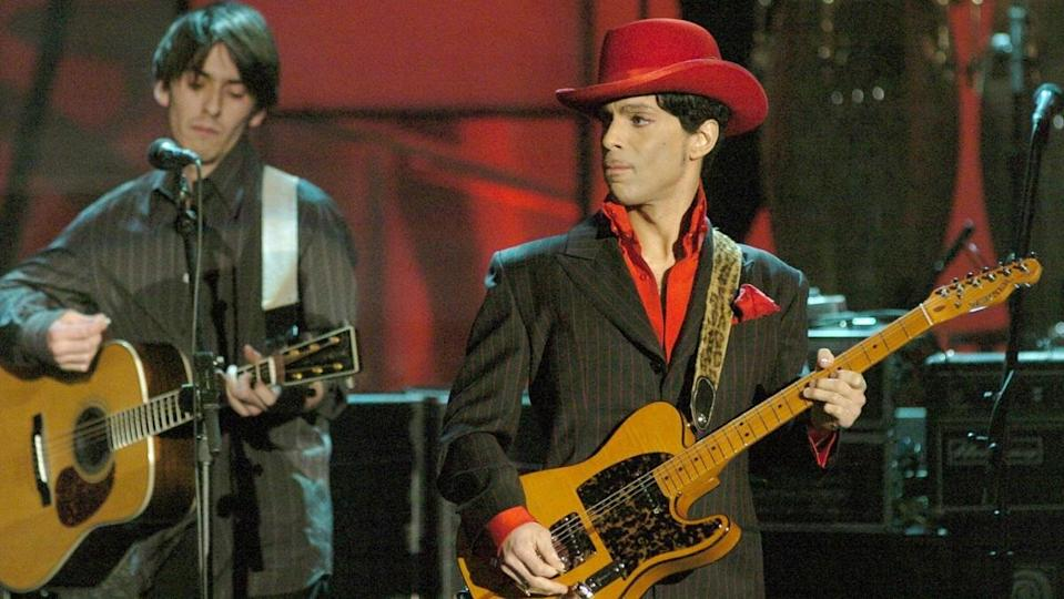 """Prince brings the house down with his guitar solo portion of George Harrison's """"While My Guitar Gently Weeps."""""""