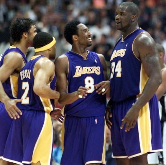 Kobe Bryant is swarmed by teammates Derek Fisher, Rick Fox and Shaquille O'Neal.