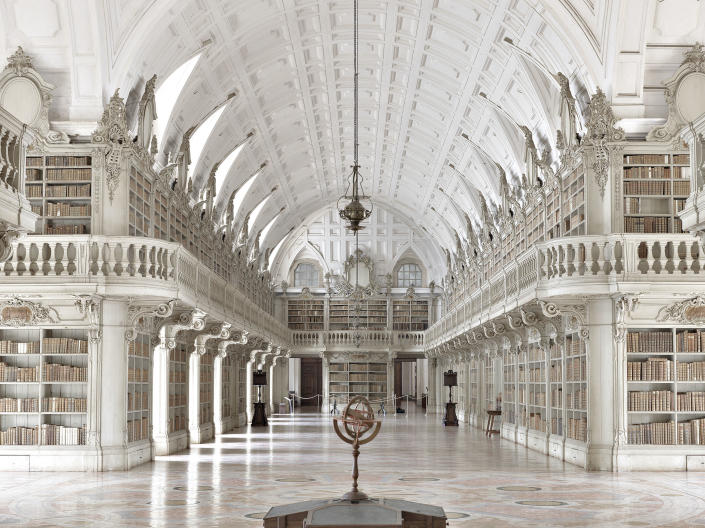 <p>Biblioteca do Convento de Mafra, Mafra, Portugal. The library contains more than 36,000 leatherbound volumes. (Photo: Massimo Listri/Caters News) </p>