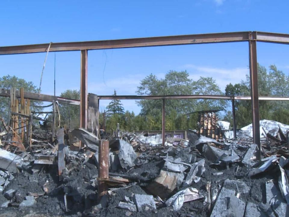 A fire at Kimball Lumber and Building Suppliers in Kingsville, Ont., was called in Sunday evening, and caused severe damage to the two-floor structure. (Jennifer La Grassa/CBC - image credit)
