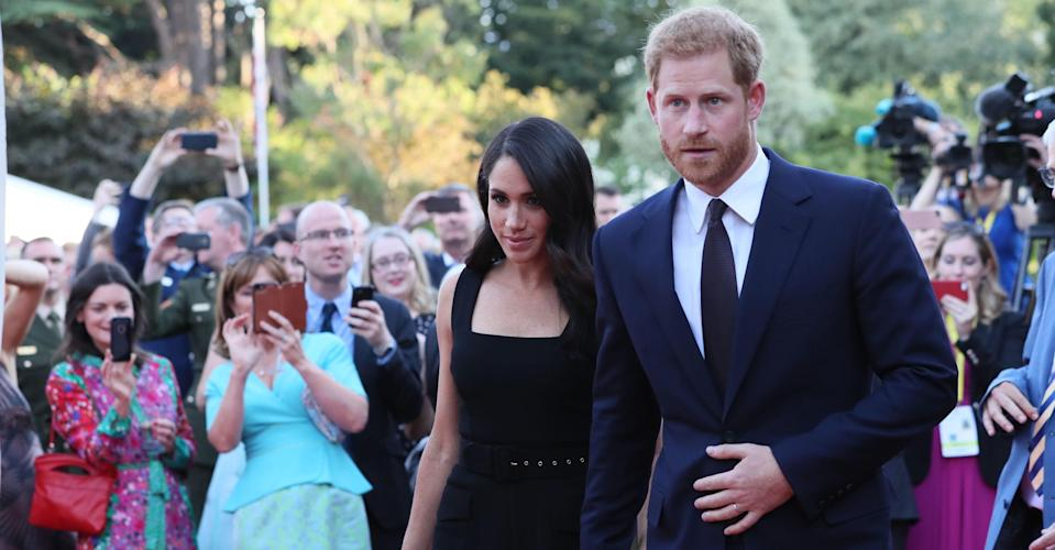The Duchess of Sussex made her third outfit change of the day and donned a chic sleeveless dress for the summer garden party [Photo: Twitter]