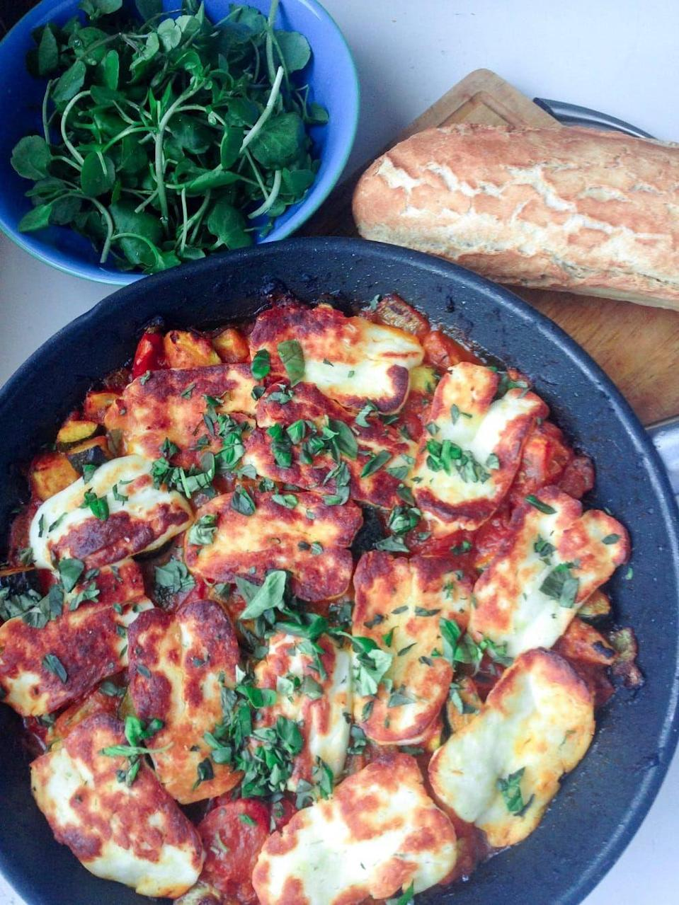 """<p>Tomatoes and halloumi are one delicious flavour combination. </p><p>Get the <a href=""""https://thecookreport.co.uk/tomato-halloumi-bake/"""" rel=""""nofollow noopener"""" target=""""_blank"""" data-ylk=""""slk:Tomato and Halloumi Bake with Courgette"""" class=""""link rapid-noclick-resp"""">Tomato and Halloumi Bake with Courgette</a> recipe. </p><p>Recipe from <a href=""""https://thecookreport.co.uk/"""" rel=""""nofollow noopener"""" target=""""_blank"""" data-ylk=""""slk:The Cook Report"""" class=""""link rapid-noclick-resp"""">The Cook Report</a>.</p>"""