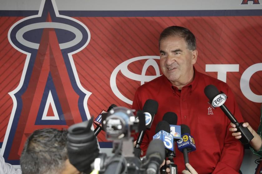 Tim Mead, the Los Angeles Angels' vice president of communications, talks to reporters during a news conference.
