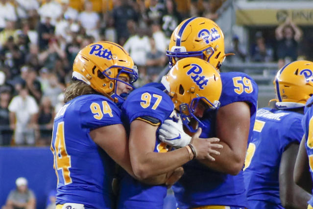 Pittsburgh placekicker Alex Kessman (97) is greeted by teammates long snapper Cal Adomitis (94) and Carson Van Lynn after he made the extra point that gave Pitt the lead over Central Florida during the second half of an NCAA college football game, Saturday, Sept. 21, 2019, in Pittsburgh. Kessman had missed two field goals in the game. (AP Photo/Keith Srakocic)