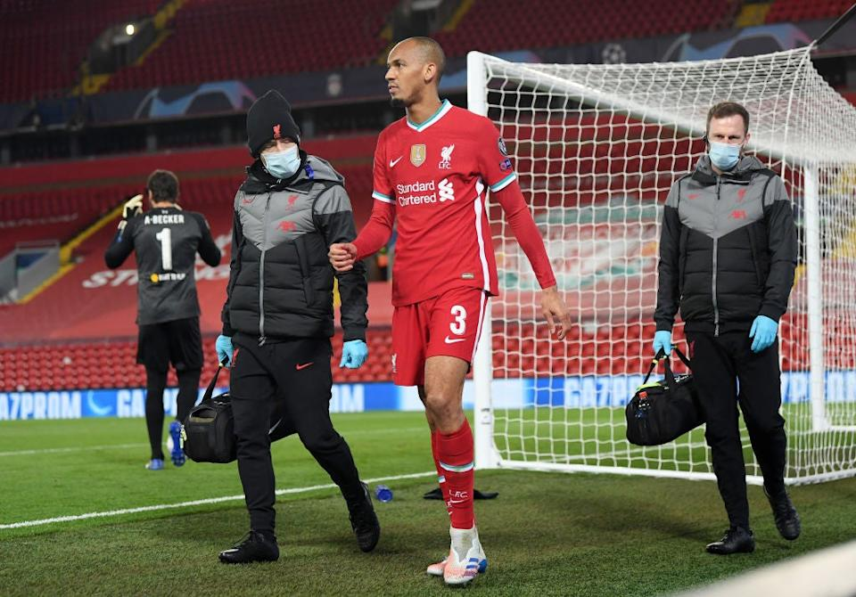 Fabinho of Liverpool walks around the pitch after he sustains an injuryGetty