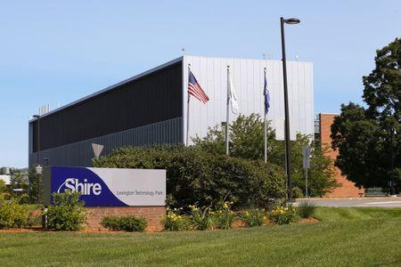 FILE PHOTO: A sign sits in front of Shire's manufacturing facility in Lexington, Massachusetts July 18, 2014. REUTERS/Brian Snyder