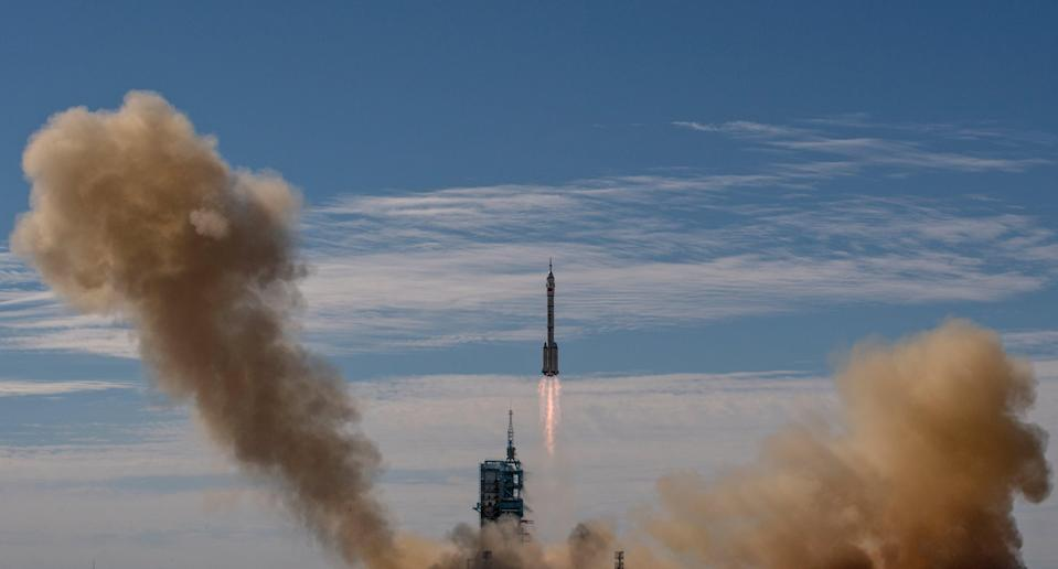 Shenzhou-12 spacecraft from China's Manned Space Agency onboard the Long March-2F rocket launches with three Chinese astronauts onboard at the Jiuquan Satellite Launch Center on 17 June, 2021, in Jiuquan, Gansu province, China (Getty Images)