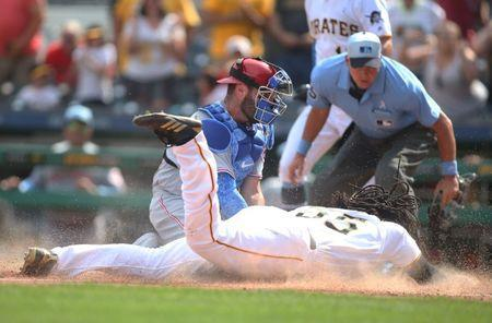 Jun 17, 2018; Pittsburgh, PA, USA; Cincinnati Reds catcher Curt Casali (38) tags Pittsburgh Pirates first baseman Josh Bell (55) out at home plate during the eighth inning at PNC Park. Mandatory Credit: Charles LeClaire-USA TODAY Sports