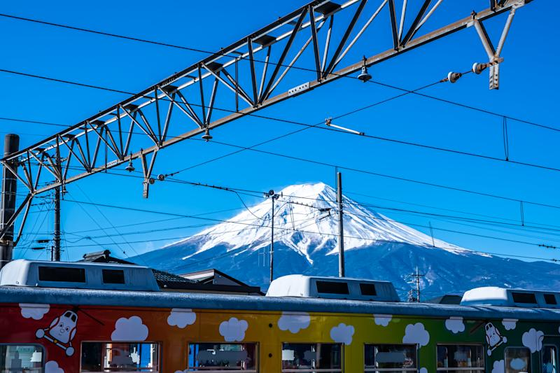 Yamanashi, Japan - March 24, 2019: View of Mount Fuji, commonly called Fuji-san in Japanese, Mount Fuji's exceptionally symmetrical cone, from a train station in Yamanashi, Japan.