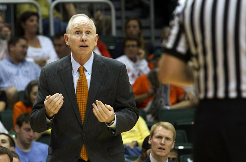 Miami's coach Jim Larranaga appeals a foul call by an official during the first half of an NCAA college basketball game against Florida State in Coral Gables, Fla., Sunday, Feb. 26, 2012. (AP Photo/J Pat Carter)