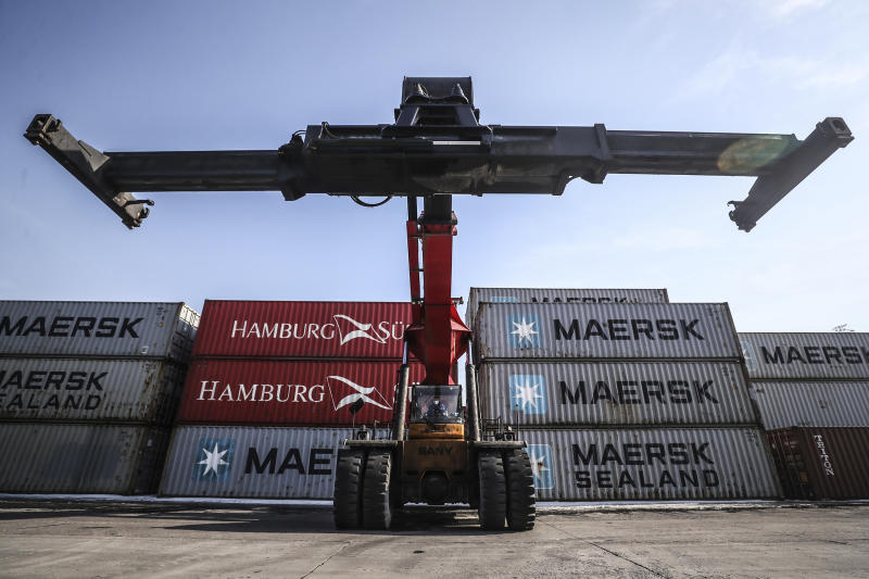 In this March 5, 2020 photo released by Xinhua News Agency, a mobile crane prepares to move containers at a logistic station of Shenyang East Railway Station in Shenyang, northeast China's Liaoning Province. China's exports fell by double digits in January and February as anti-virus controls closed factories, while imports sank by a smaller margin. (Pan Yulong/Xinhua via AP)