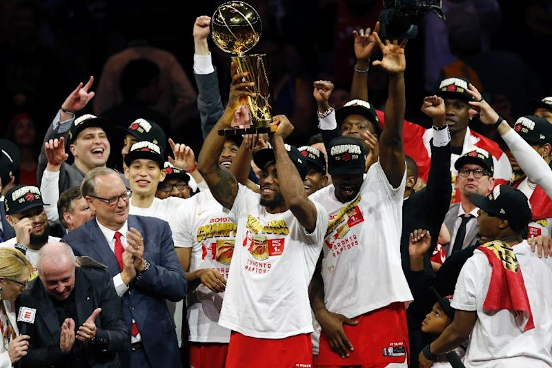 The Toronto Raptors celebrate after winning the NBA title Thursday, defeating Golden State 114-110 to win the NBA Finals four games to two (AFP Photo/Lachlan Cunningham)