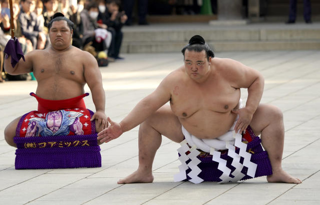 FILE - In this Jan. 9, 2018, file photo, sumo grand champion Kisenosato, right, of Japan performs his ring entry form with sward-holder Shohozan at the Meiji Shrine in Tokyo. Grand champion Kisenosato, the only Japanese wrestler at sumo's highest rank, has decided to retire after three straight losses at the New Year Grand Sumo Tournament. Kisenosato needed a strong start to the New Year tourney to salvage his career but wasn't able to win in the first three days and decided to retire, his stablemaster said on Wednesday, Jan. 16, 2019. (AP Photo/Shizuo Kambayashi, File)
