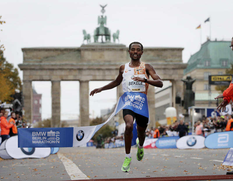 Ethiopia's Kenenisa Bekele crosses the finish line to win the 46th Berlin marathon in Berlin, Germany, Sunday, Sept. 29, 2019. (AP Photo/Michael Sohn)