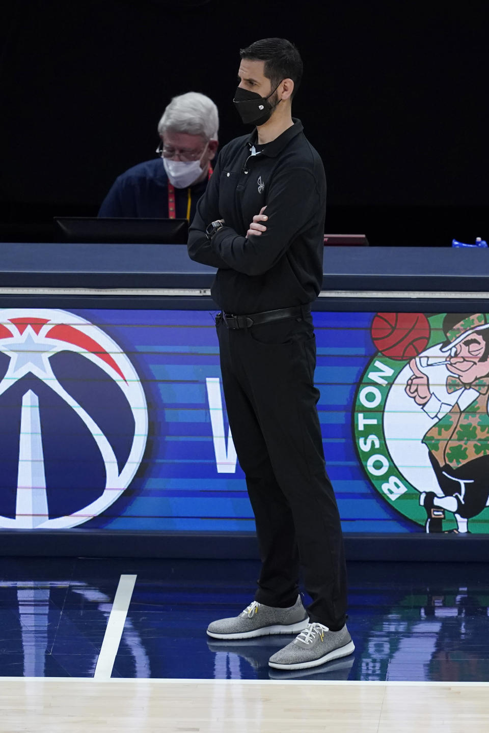 Charlotte Hornets coach James Borrego watches during the second half of the team's NBA basketball Eastern Conference play-in game against the Indiana Pacers, Tuesday, May 18, 2021, in Indianapolis. Indiana won 144-117. (AP Photo/Darron Cummings)