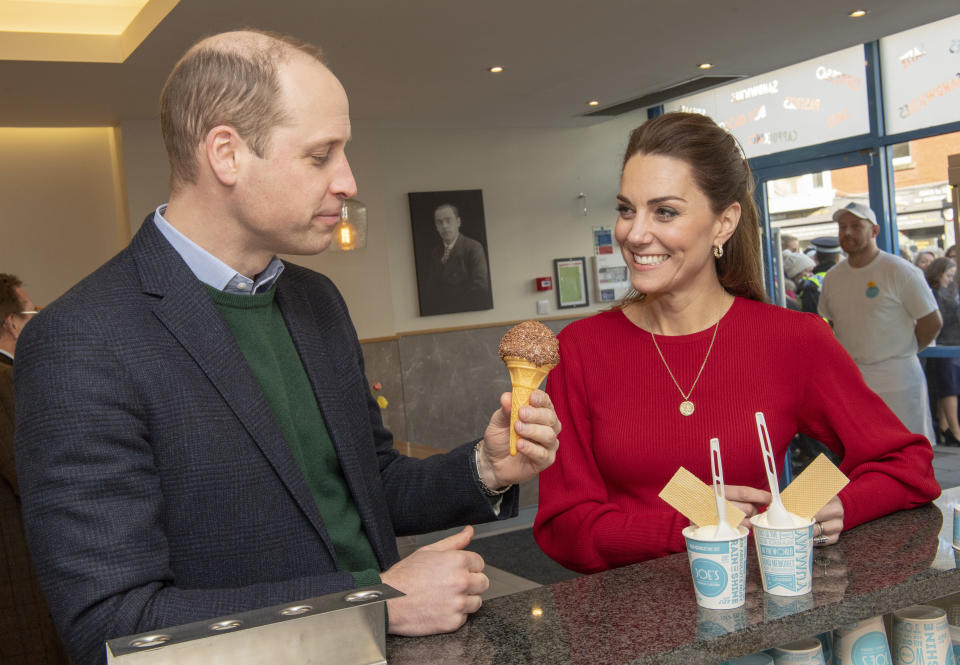 SWANSEA, UNITED KINGDOM - FEBRUARY 04: Prince William, Duke of Cambridge and Catherine, Duchess of Cambridge eat ice cream during a visit to Joe's Ice Cream Parlour in the Mumbles to meet local parents and carers on February 04, 2020 near Swansea, South Wales.The Duchess of Cambridge launched a landmark survey '5 Big Questions on the Under Fives' on the 21st January which aims to spark a UK-wide conversation on raising the next generation. (Photo by Arthur Edwards - WPA Pool/ Getty Images)